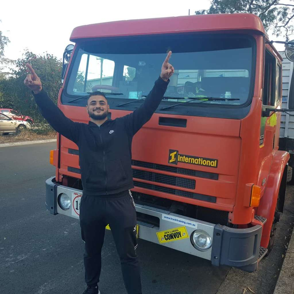 Davids Truck Training student red truck adidias